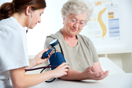 internist measuring blood pressure