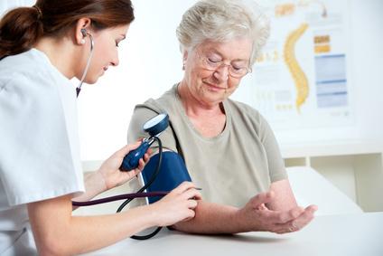 internist measuring blood pressure
